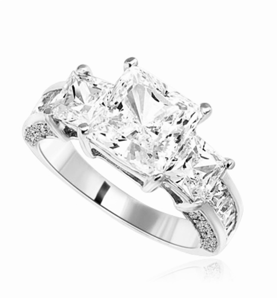 Three Stones Sparkling Ring With Princess Cut Diamond Essence Set in center accompanied by Princess Cut Diamond Essence on each side with channel set Princess stones on band and Melee on side of the band. 3.25Cts T.W. set in Platinum Plated Strling Silver