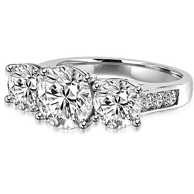Impressive Three Stone Ring with artistically set triple Diamond Essence stones on the band, an enchanting 4.0 Cts.T.W. in Platinum Plated Sterling Silver.