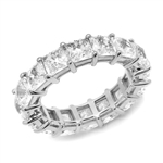 Diamond Essence Eternity Band With French Cut Stones, Approx 4 Cts.T.W. In Platinum Plated Sterling Silver.