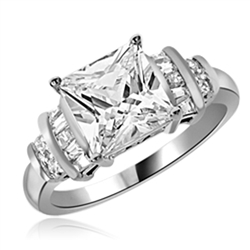 Diamond Essence Designer Ring With 3 Cts. Princess Cut Center Set in Four Prongs, Baguettes and Melee On Each Side,3.50Cts.T.W in Platinum Plated Sterling Silver.