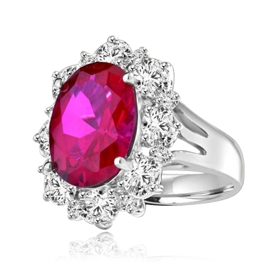 Gorgeous Ring with 8.25 Cts. Oval Cut Ruby Essence in center, surrounded by Oval cut Diamond Essence and Round Brilliant Melee. 10.25 Cts T.W. set in Platinum Plated Sterling Silver.