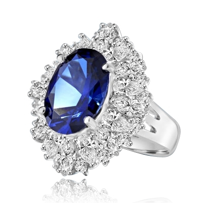 Medley Magic - Artistically set mixture of Marquise cut, Pear cut and Round cut Diamond Essences around 6.0 Cts. Oval cut Sapphire Essence in center. Perfect for Party. 10.0 Cts T.W. set in Platinum Plated Sterling Silver