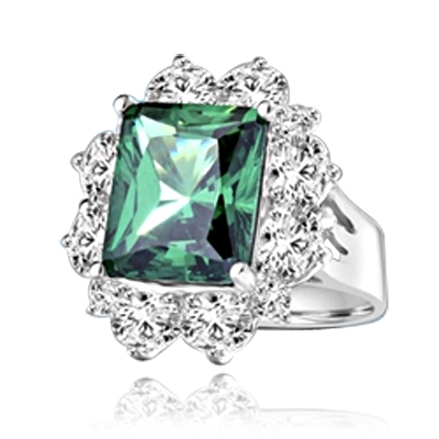 Gorgeous Green - 6.0 Cts. Emerald cut Emerald Essence in center surrounded by Oval cut Diamond Essence and Melee. 9.0 Cts T.W. set in Platinum Plated Sterling Silver.