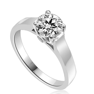 Diamond Essence Solitaire Ring Artistically set in wide band with a beautiful accent  on both sides to enhance the looks set in Platinum Plated Sterling Silver.