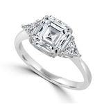Diamond Essence Ring with 3 Cts. Asscher Cut center Stone and 0.25 Ct Trilliant Stone On Each Side, 3.50 Cts.T.W. In Platinum Plated Sterling Silver.