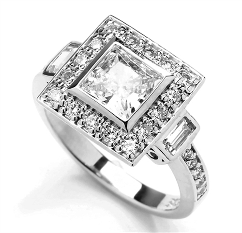 Diamond Essence Designer Ring With 1.50 Cts. Princess stone In Center and Round Melee On Four Sides And Band, 2.25 Cts.T.W. In Platinum Plated Sterling Silver.