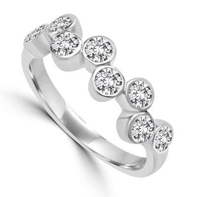 Diamond Essence Ring with 0.20 Ct. Each Round Brilliant Stone In Platinum Plated Sterling Silver ZigZag Bezel Setting.