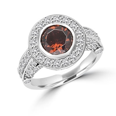Diamond Essence Designer Ring with 1.5 cts.Chocolate Center, surrounded by small round stones.3.0 cts. tw. in Platinum Plated Sterling Silver.