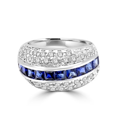 Diamond and Sapphire Ring - Impressive ring, one row of 2.0 Cts. Princess Cut Sapphire Essence stones in center with two rows of melee on each side. 2.50 Cts.T.W. set in Platinum Plated sterling Silver.