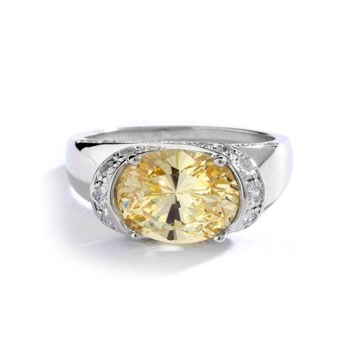 East West Ring- Oval cut Canary Essence set in center with Melee set on side setting going around in criss cross design from center, down the side of the band. 3.25 Cts T.W. set Platinum Plated Sterling Silver.