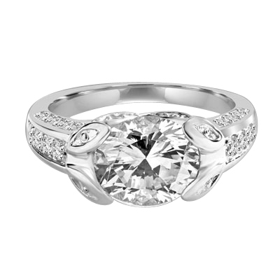 Designer Ring with 3.0 Cts. Round Brilliant Diamond Essence, artistically set in leaf shaped prongs in center, set off by Melee on either side of the band. 4.0 Cts. T.W. set in Platinum Plated Sterling Silver.