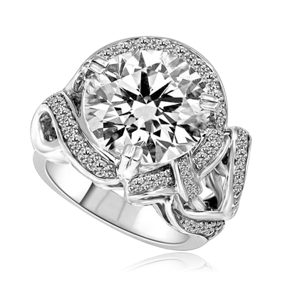 Outstanding - 8.5 Cts. Round Brilliant Diamond Essence shinning in center surrounded by Melee in curvy setting. Perfect for any Occasion!! 9.5 Cts. T.W. set in Platinum Plated Sterling Silver.