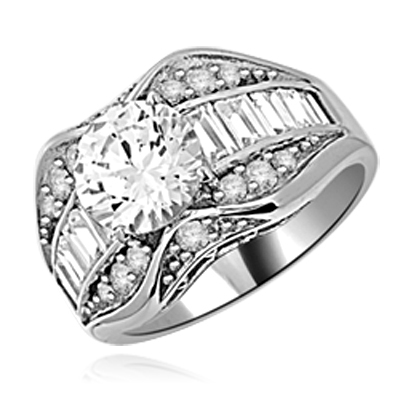 Designer Ring with 2.0 Cts. Round Diamond Essence in center, accompanied by Baguettes and Melee on band, 4.0 cts.t.w. set in Platinum Plated Sterling Silver. Available in select Ring sizes.