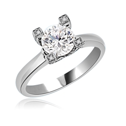 Solitaire Ring with 2.0 Cts. Round Brilliant Diamond Essence center set in stone studded wide prongs. Available in select Ring sizes.