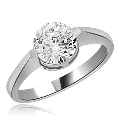 Solitaire Ring with 2.0 Cts. Round Diamond Essence in center, in Platinum Plated Sterling Silver.  Available in select Ring sizes.