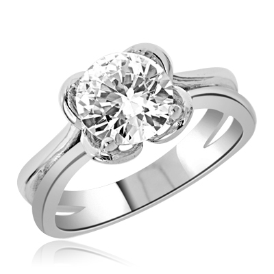 Solitaire Ring with 2.0 Cts. Round Brilliant Diamond Essence, artistically set in four prong setting. Available in select Ring Sizes.