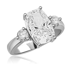 Diamond Essence ring with 12 x 8 Cushion Cut center and 2 brilliant rounds. 5.50 cts.t.w. set in  Platinum Plated Sterling Silver.