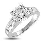 Baguetted Beauty! 1.25 Cts. Round Brilliant Diamond Essence mounts on top pf elegant Baguettes on the band. Appx. 2.5 Cts. T.W.