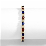 "Perfect party wear. 7"" long Diamond Essence Vermeil bracelet, in alternate setting of oval cut Sapphire Essence and Garnet Essence stones, 0.5 carat each in four prongs. Diamond Essence melee set in between for more dramatic look. 12 cts.t.w."