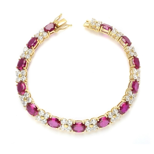 "7"" long Diamond Essence Designer Bracelet with 1.25 Cts. each Oval cut Ruby Essence and Round Diamond Essence Stones. Appx. 27.0 Cts. T.W. set in 14K Gold Vermeil."
