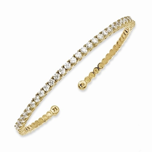 Sterling Silver Gold-Plated Cuff Bracelet, 31 Round Brilliant Diamond Essence stones set in four prongs setting. Approximate 3.0 cts.t.w.