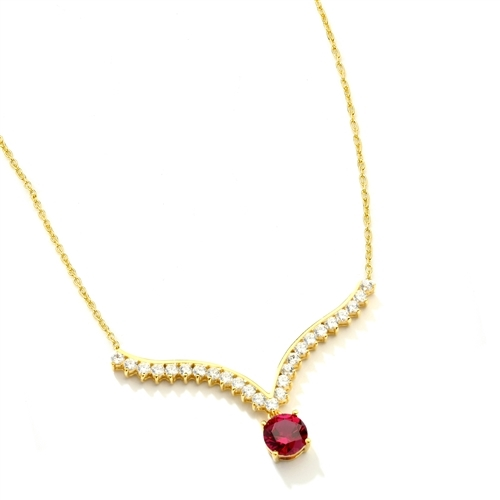 Supreme Necklace that is sure shot eye candy! 2.0 Cts. Round cut Ruby Essence Dangler atones a curvy melee of Round Brilliants set exquisitely in an Art Deco Setting! 3.50 Cts.T.W. attached with Chain in 14K Gold Vermeil.