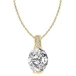 Diamond Essence masterpiece of 3.0 ct. oval-cut stone set in Gold Vermeil, crowned with sparkling round stones. Chain not included.