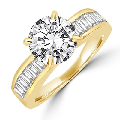 Diamond Essence Ring with 2.0 ct. Round Diamond Essence center with channel set baguettes on each side,2.5 ct. tw.in Gold Vermeil.