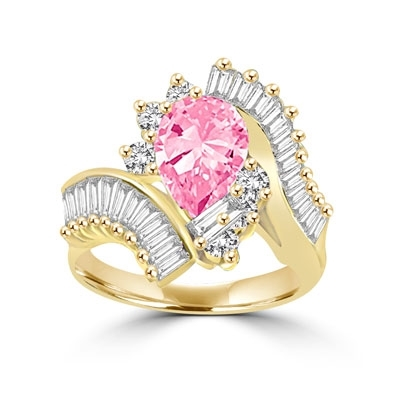 A beautiful designer ring. Diamond Essence Pink Pear cut stone of 2.5 carat supported by round brilliant melees and artistically curved shank with brilliant baguettes gives an extraordinary look and compliments. Must have one. 4.80 cts.T.W.