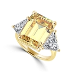 Designer Ring with 13.0 cts. Canary Essence Emerald in center and triangle stones on each side. 21.0 Cts. T.W. set in 14K Gold Vermeil.