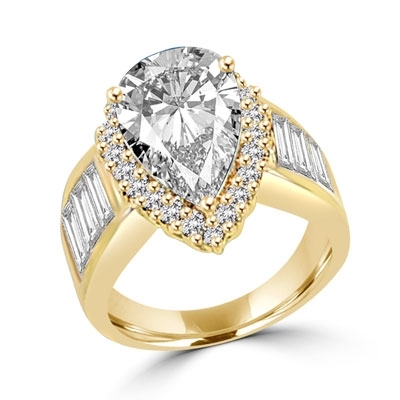 Mesmerizing ring with 4.0 cts. pear cut center, accents and baguettes  set in Gold Vermeil.