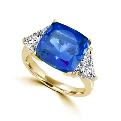 Sapphira - Fantastic Ring with a plush 4 Ct. Cushion Cut Sapphire Essence Masterpiece that highlights by each side of Trilliant accents.6 Cts. t.w. in 14K Solid White Gold, to chase your blues away!
