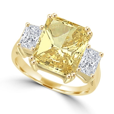 Gold ring with 7 ct emerald-cut canary stone and side baguettes