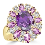This designer ring is just perfect for party lovers to show-off. 3.0 ct. oval cut amethyst, surrounded by 8 small amethyst marquise,1.3 cts.and white round stones 0.80 cts. all around it, 5.10 cts T.W. set in 14KGold Vermeil.