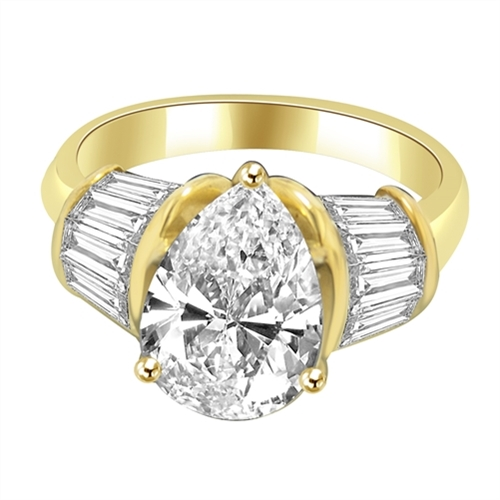 Majestic Pear cut Diamond Essence ring. 3 carat Pear center encircled by baguettes accents on either side. 5.0 cts.t.w. in Gold Vermeil.
