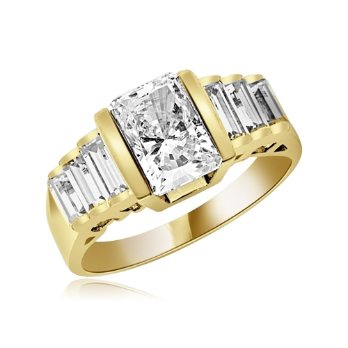 Great looking band with graduating baguettes on the band and 1.5 ct. radiant emerald Diamond Essence center, set in thick bar setting. 2.5 cts.t.w. in Gold Plated Sterling Silver.