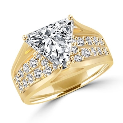 Magnificent Ring with 4Ct. Trilliant Cut Center adorning the mount on a glimmering band with melee of Round brilliant accents. 5.5 Cts. T.W. in 14k Gold Vermeil.