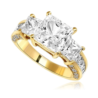 Three Stones Sparkling Ring With Princess Cut Diamond Essence Set in center accompanied by Princess Cut Diamond Essence on each side with channel set Princess stones on band and Melee on side of the band. 3.25 Cts T.W. set in 14 K Gold Vermeil.