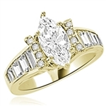 Diamond Essence Designer Ring With Marquise cut Diamond Essence, 1.50 Cts set in six prongs and Diamond Essence Melee on two sides on curved bars,The band is enhanced with Diamond Essence baguettes, 3.50 Cts.T.W. in 14k Gold Vermeil.