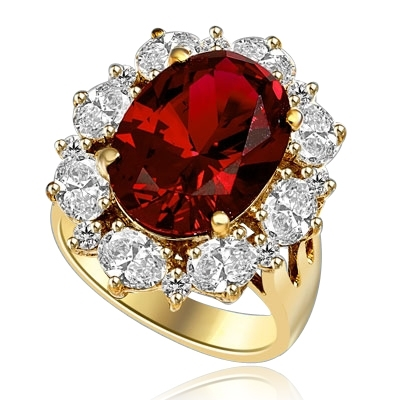 Gorgeous Ring with 8.25 Cts. Oval Cut Ruby Essence in center, surrounded by Oval cut Diamond Essence and Round Brilliant Melee. 10.25 Cts T.W. set in 14K Gold Vermeil.