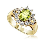 Floral Ring - 1.25 Cts. Oval cut Peridot Essence set in center with Round brilliant Diamond Essence on top and bottom and cluster of Melee, making floral design, on either side of band. 2.0 Cts. T.W. set in 14K Gold Vermeil.