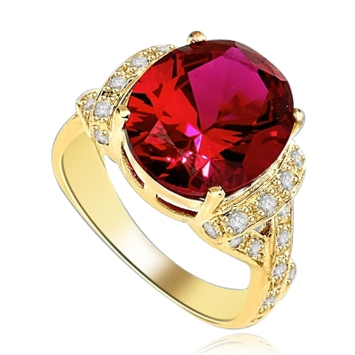 Ruby Ring- 6.0 Cts Oval Cut Ruby Essence in center accompanied by Melee on the band making criss cross design. 6.50 Cts. T.W. set in 14K Gold Vermeil.