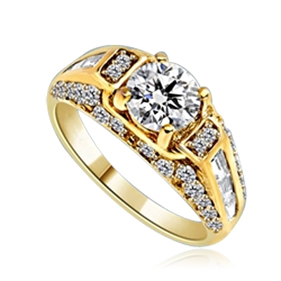 Engagement Ring- 1.0 Ct. round Brilliant Diamond Essence in center with Chanel set Baguettes and Melee going half way down the band. 2.0 Cts. T.W. set in 14K Gold Vermeil.