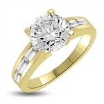 Baguetted Beauty! 1.25 Cts. Round Brilliant Diamond Essence mounts on top pf elegant Baguettes on the band. Appx. 2.5 Cts. T.W. set in 14K Gold Vermeil.