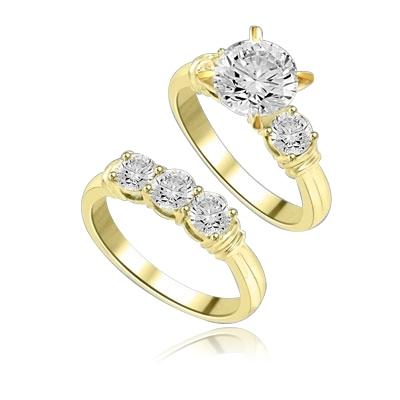 Wedding Ring Set with 2 Ct. Round Brilliant Center and 1.25 Ct. Accent Stones. The Wide Prong is Two Tone to enhance the beauty! 3.25 Cts.T.W. In 14k Gold Vermeil.