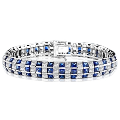 "7"" long Lovely best selling bracelet with 23.25 cts.t.w. of Princess cut Sapphire Essence and Princess cut Diamond Essence stones in 14K Solid White Gold."