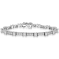 Beautiful Designer Bracelet, with Diamond Essence Princess cut masterpieces linked interestingly with cusp of round accent in ethnic looks. Appx. 7.0 Cts.T. W. in 14k Solid White Gold.