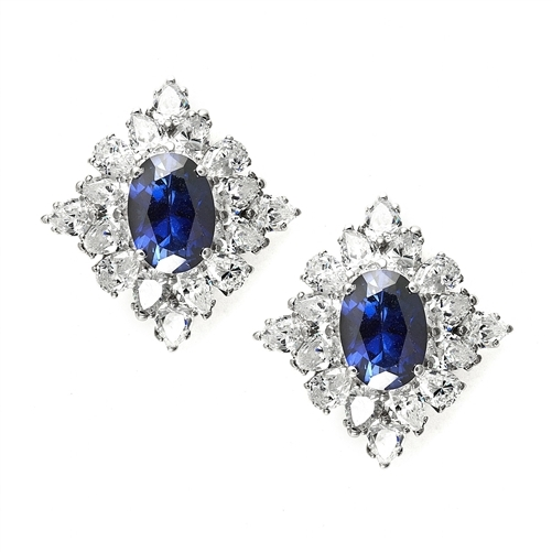 Designer Earrings with 3.5 ct. oval Sapphire Essence set in four prong, and surrounded by pear cut diamond essence stones in floral pattern. 8.5 cts. each earring. 17.00Cts. T.W. set in 14K Solid White Gold.