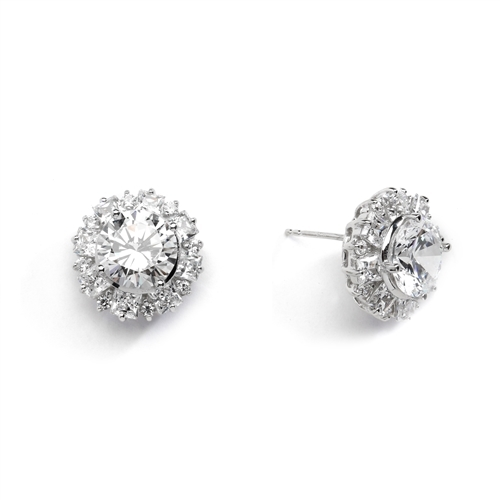 Designer Earrings With Round Brilliant Diamond essence in center surrounded by alternately set Princess and melee. 14.5 Cts T.W. set in 14K White Gold.