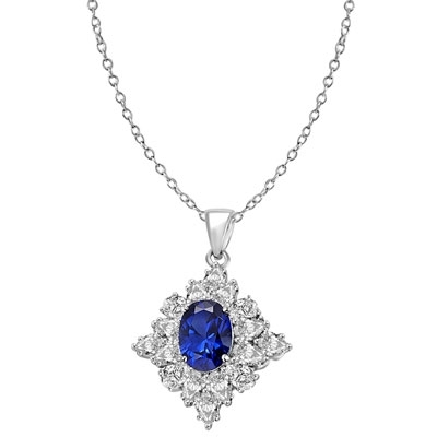 Designer pendant with 3.5 Ct. oval Sapphire Essence set in four prongs, and surrounded by pear cut diamond essence stones in floral pattern. 8.5 Cts. T.W. et in 14K Solid White Gold.